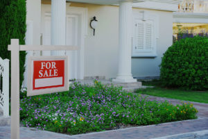 White House front door with big columns and for sale sign